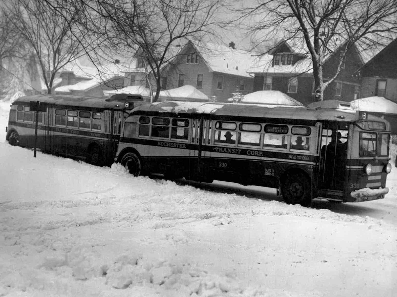 In this 1942 photo, a city bus finds the going difficult on Genesee Park Boulevard following a snowfall.