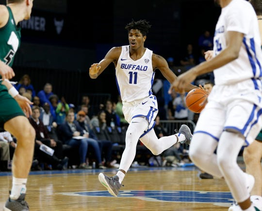 Feb 19, 2019; Buffalo, NY, USA; Buffalo Bulls forward Jeenathan Williams (11) brings the ball up the court during the second half against the Ohio Bobcats at Alumni Arena.