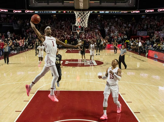Temple's Quinton Rose, left, goes up for the dunk during the second half of an NCAA college basketball game against Central Florida, Saturday, March 9, 2019, in Philadelphia. Temple won 67-62.