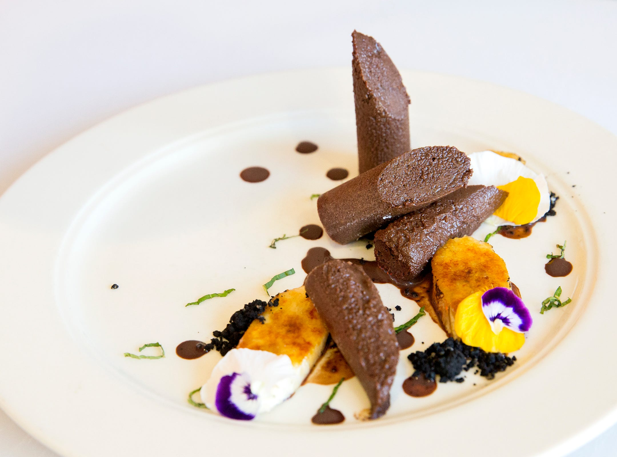 McMinville's Chocolate Flourless Cake dessert is served for the judges during the ORLAEF's ProStart Invitational, a statewide high school culinary competition, at the Salem Convention Center on March 18, 2019.