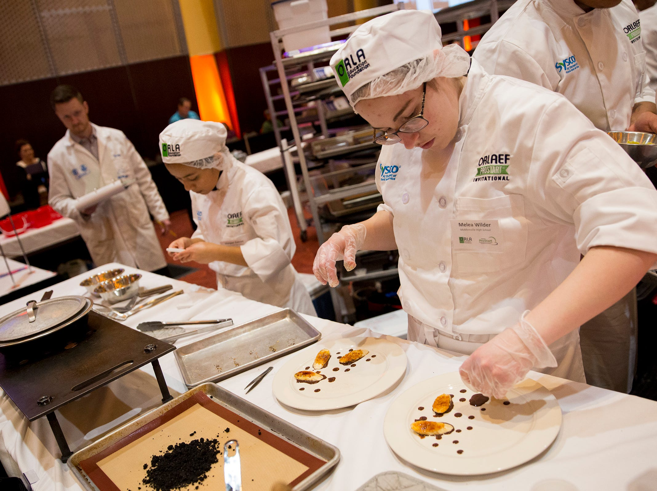 McMinnville's Melea Wilder works on a desert dish during the ORLAEF's ProStart Invitational, a statewide high school culinary competition, at the Salem Convention Center on March 18, 2019.