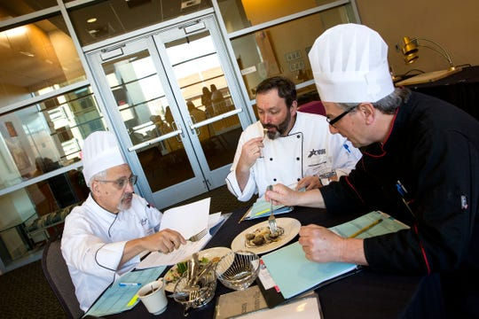 Judges taste the final dishes during the ORLAEF's ProStart Invitational, a statewide high school culinary competition, at the Salem Convention Center on March 18, 2019.