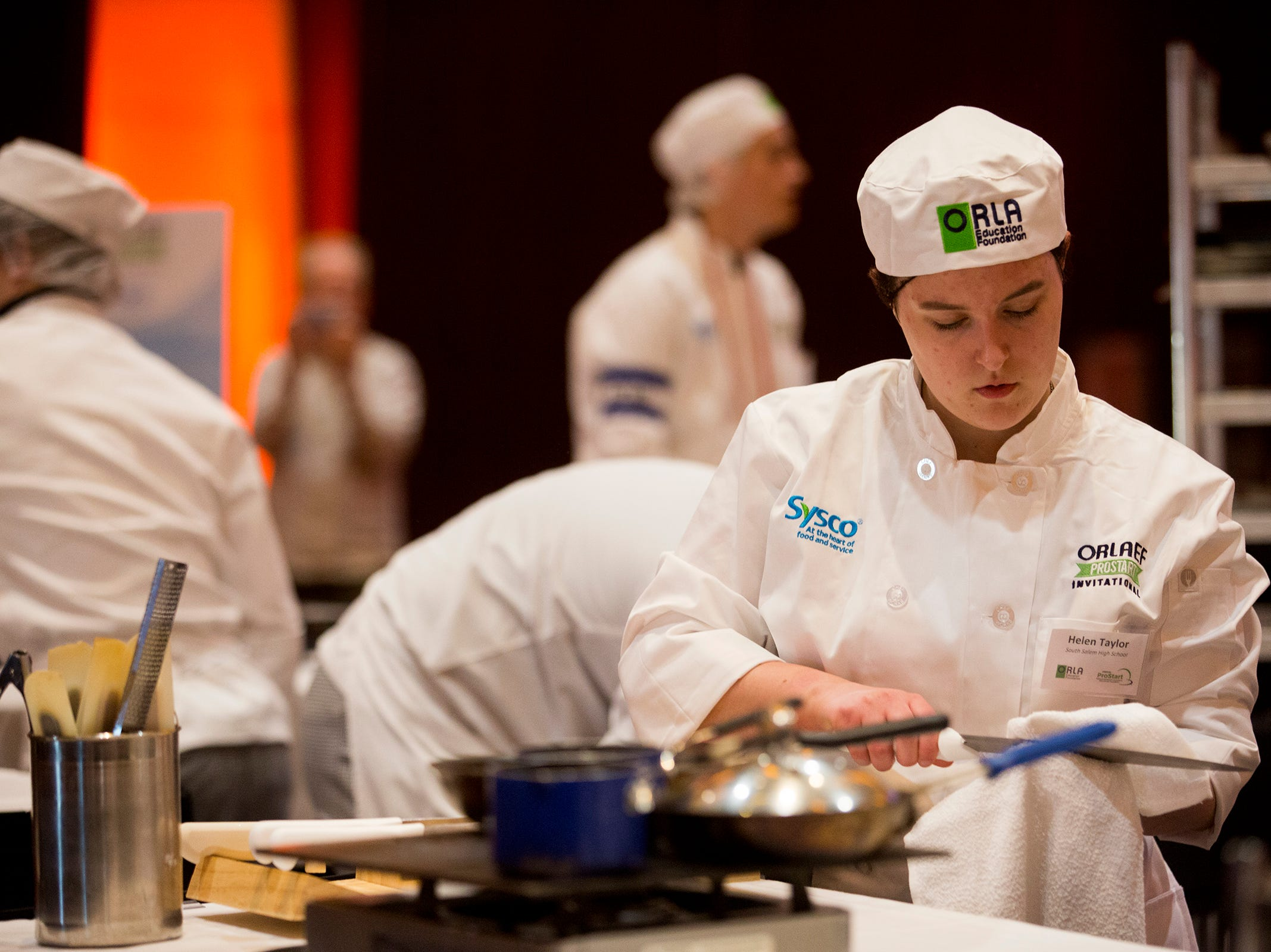 South Salem's Helen Taylor prepares knives to use during the ORLAEF's ProStart Invitational, a statewide high school culinary competition, at the Salem Convention Center on March 18, 2019.