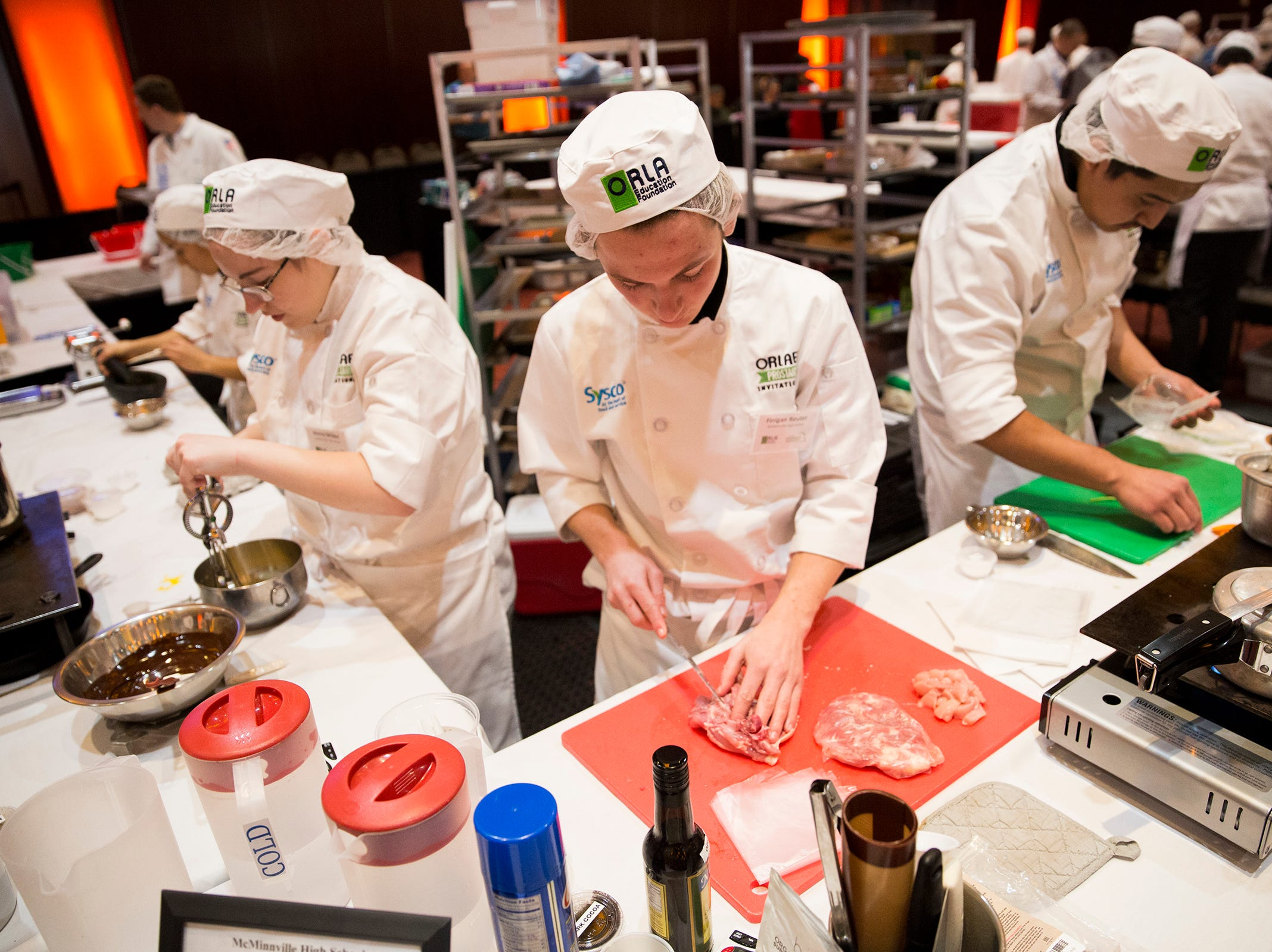 McMinnville High School culinary students prepare their dishes during the ORLAEF's ProStart Invitational, a statewide high school culinary competition, at the Salem Convention Center on March 18, 2019.