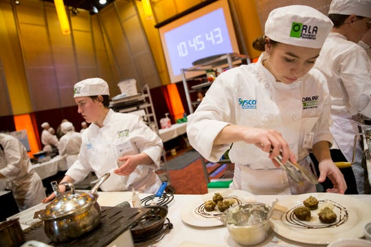 South Salem's Kristen Derting prepares a mushroom appetizer dish during the ORLAEF's ProStart Invitational, a statewide high school culinary competition, at the Salem Convention Center on March 18, 2019.