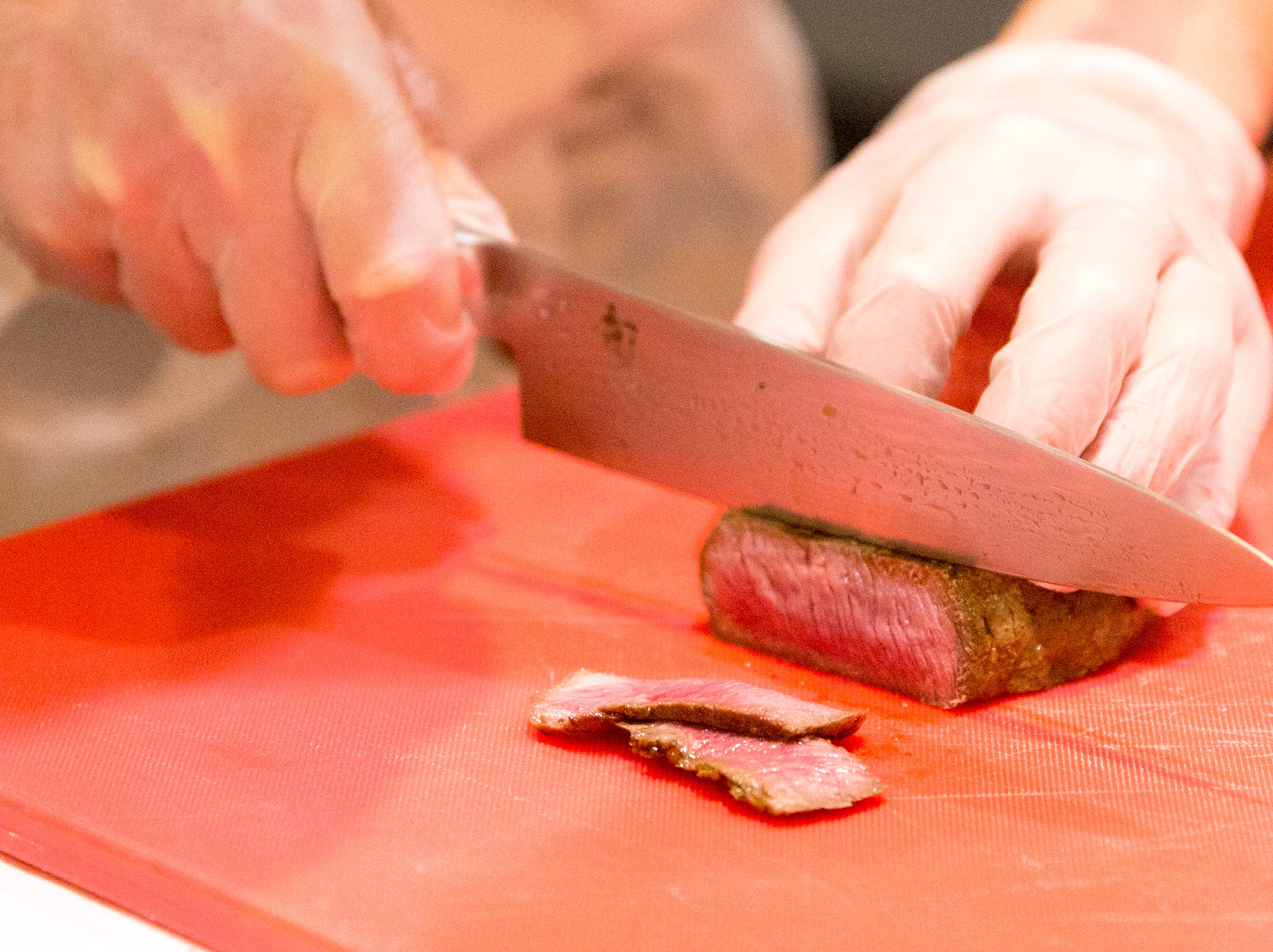Mcminnville's Finigan Reuter cuts sirloin steak during the ORLAEF's ProStart Invitational, a statewide high school culinary competition, at the Salem Convention Center on March 18, 2019.