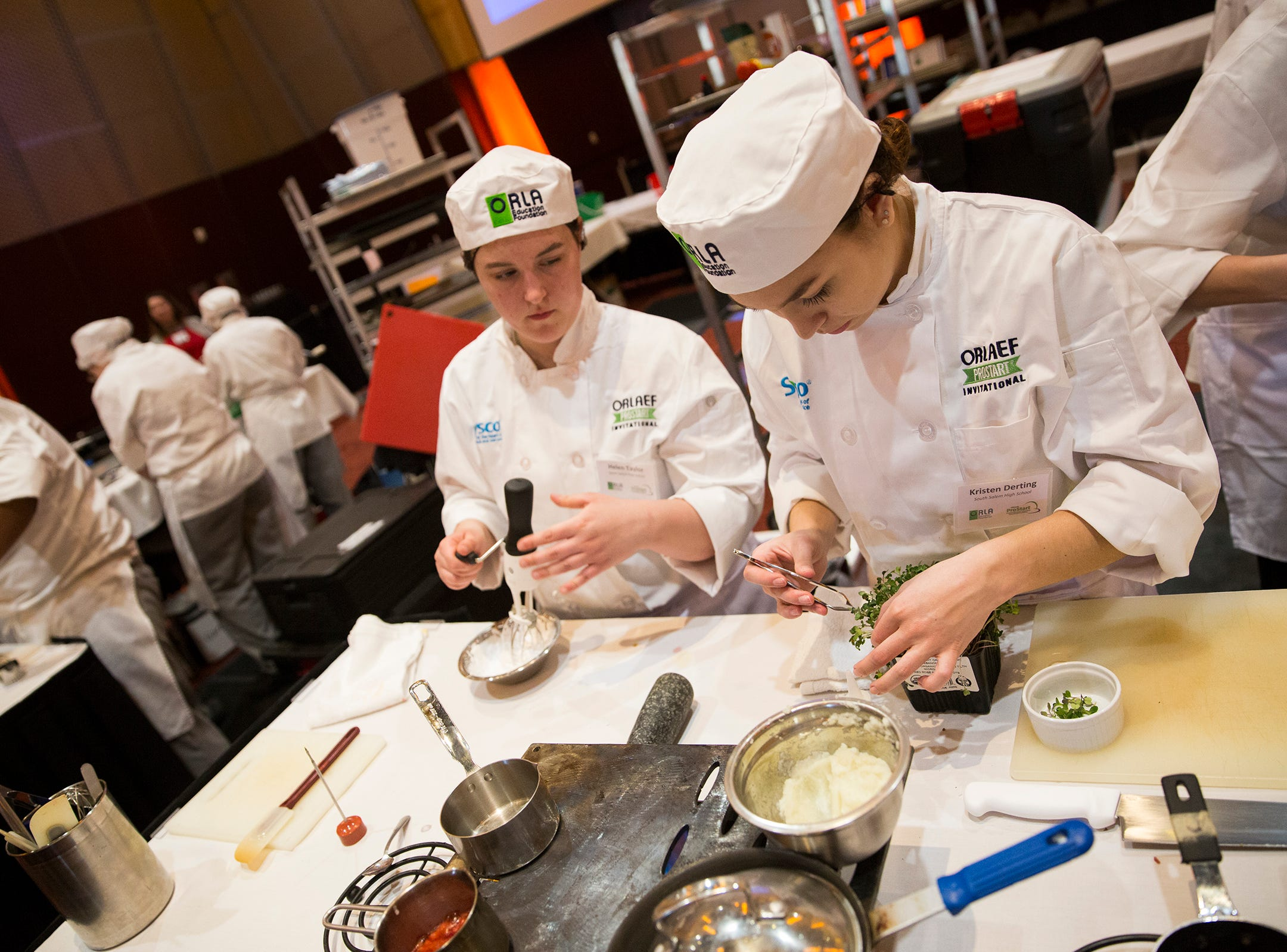 South Salem's Kristen Derting prepares herbs during the ORLAEF's ProStart Invitational, a statewide high school culinary competition, at the Salem Convention Center on March 18, 2019.