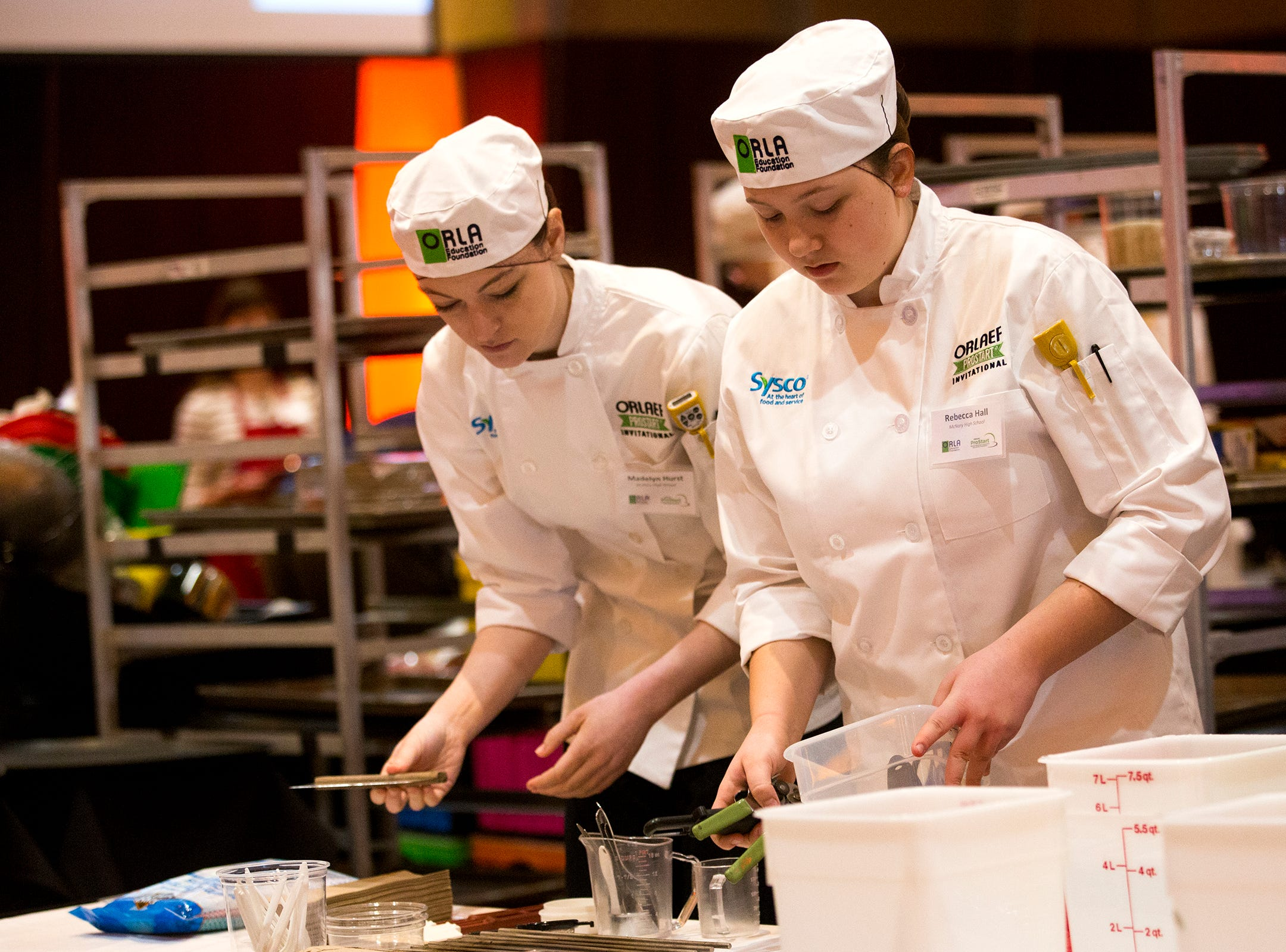 McNary's students Madelyn Hurst and Rebecca Hall set up their working area during the ORLAEF's ProStart Invitational, a statewide high school culinary competition, at the Salem Convention Center on March 18, 2019.