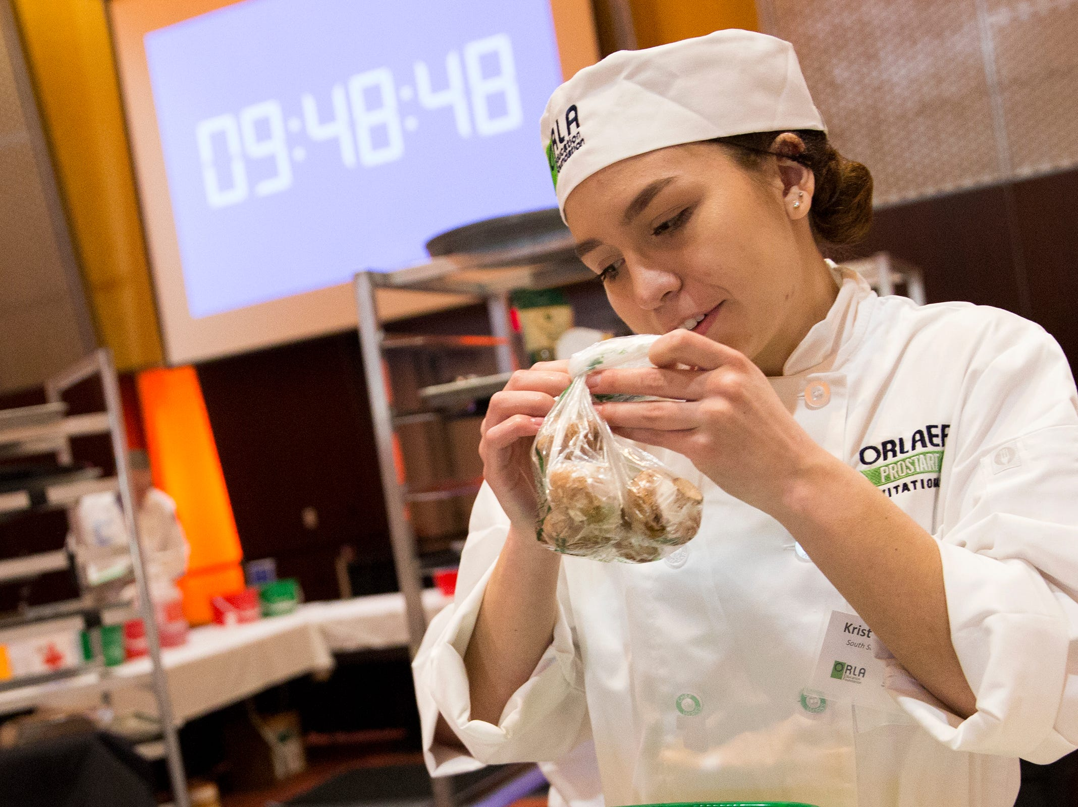 South Salem's Kristen Derting prepares mushrooms during the ORLAEF's ProStart Invitational, a statewide high school culinary competition, at the Salem Convention Center on March 18, 2019.