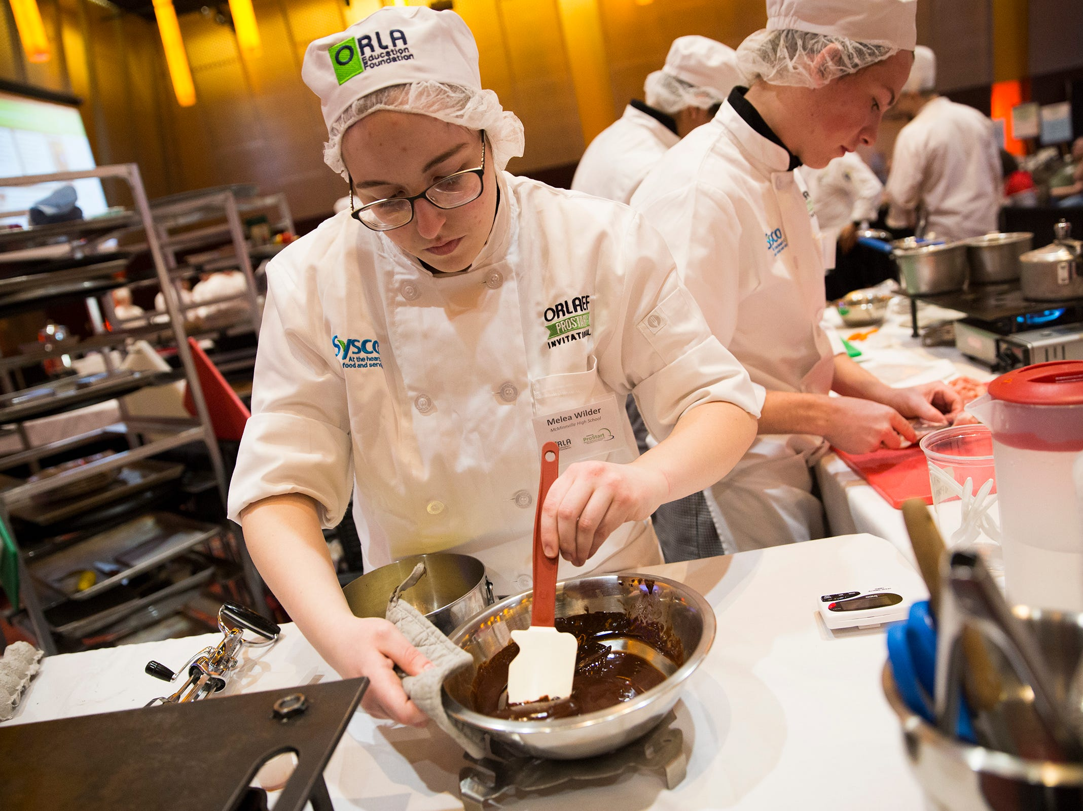 McMinnville's Melea Wilder mixes a bowl of chocolate for the teams desert dish during the ORLAEF's ProStart Invitational, a statewide high school culinary competition, at the Salem Convention Center on March 18, 2019.