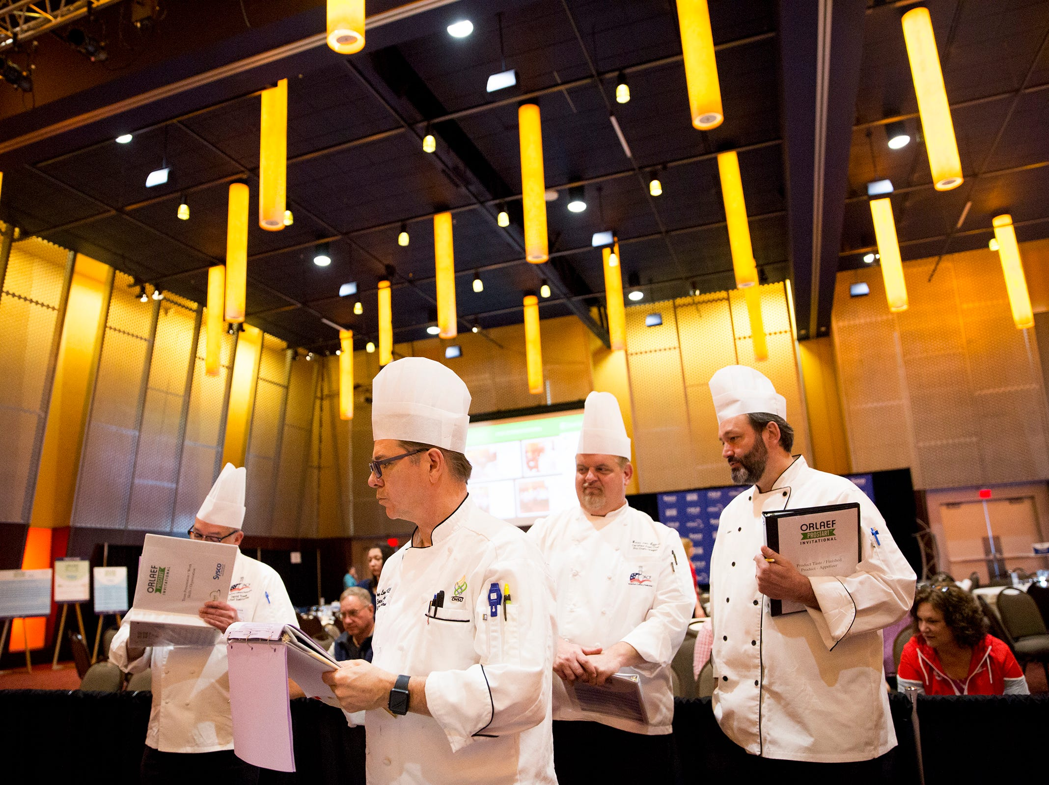 Judges take notes during the ORLAEF's ProStart Invitational, a statewide high school culinary competition, at the Salem Convention Center on March 18, 2019.