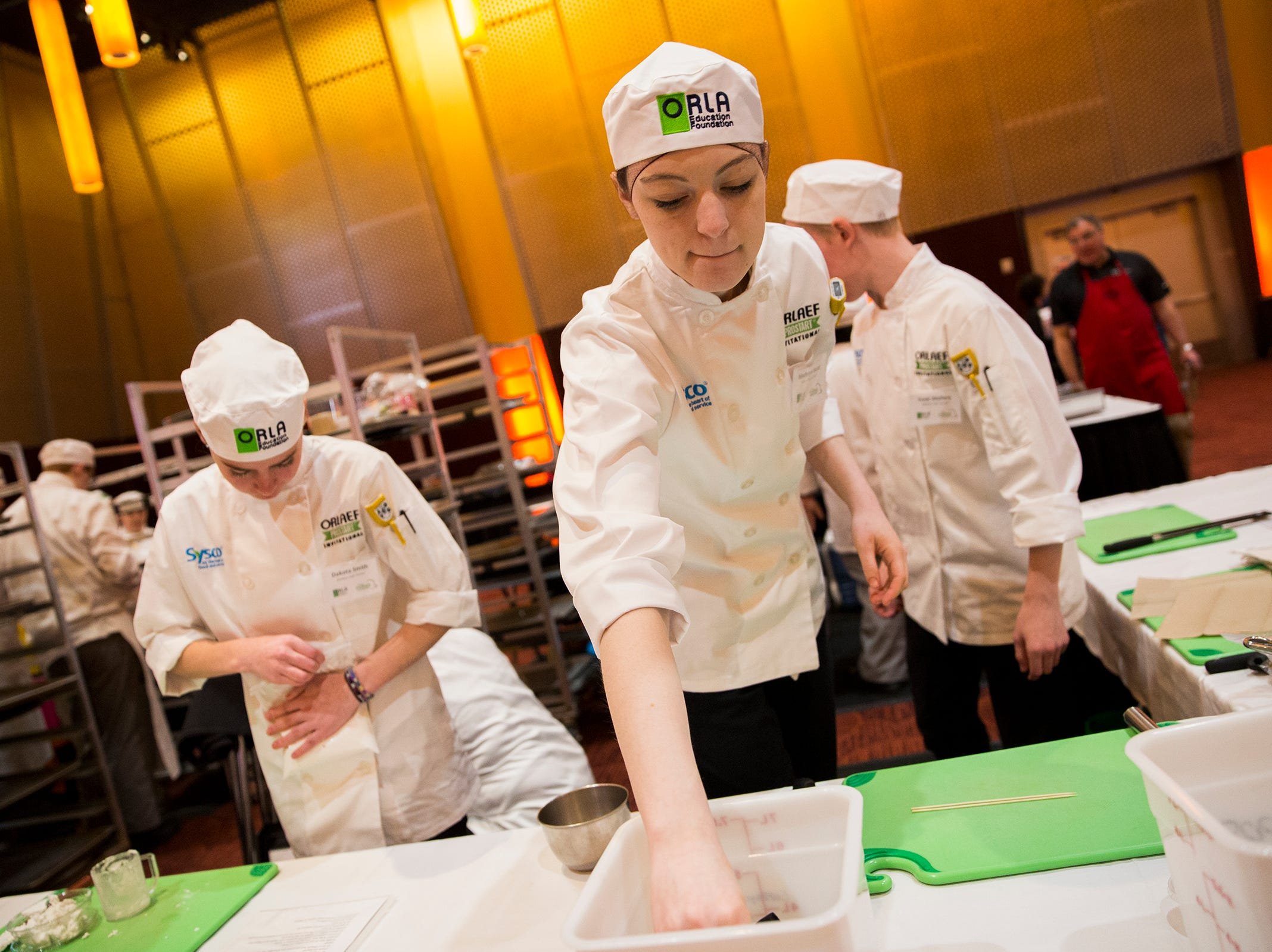McNary's Madelyn Hurst sets up her working area during the ORLAEF's ProStart Invitational, a statewide high school culinary competition, at the Salem Convention Center on March 18, 2019.