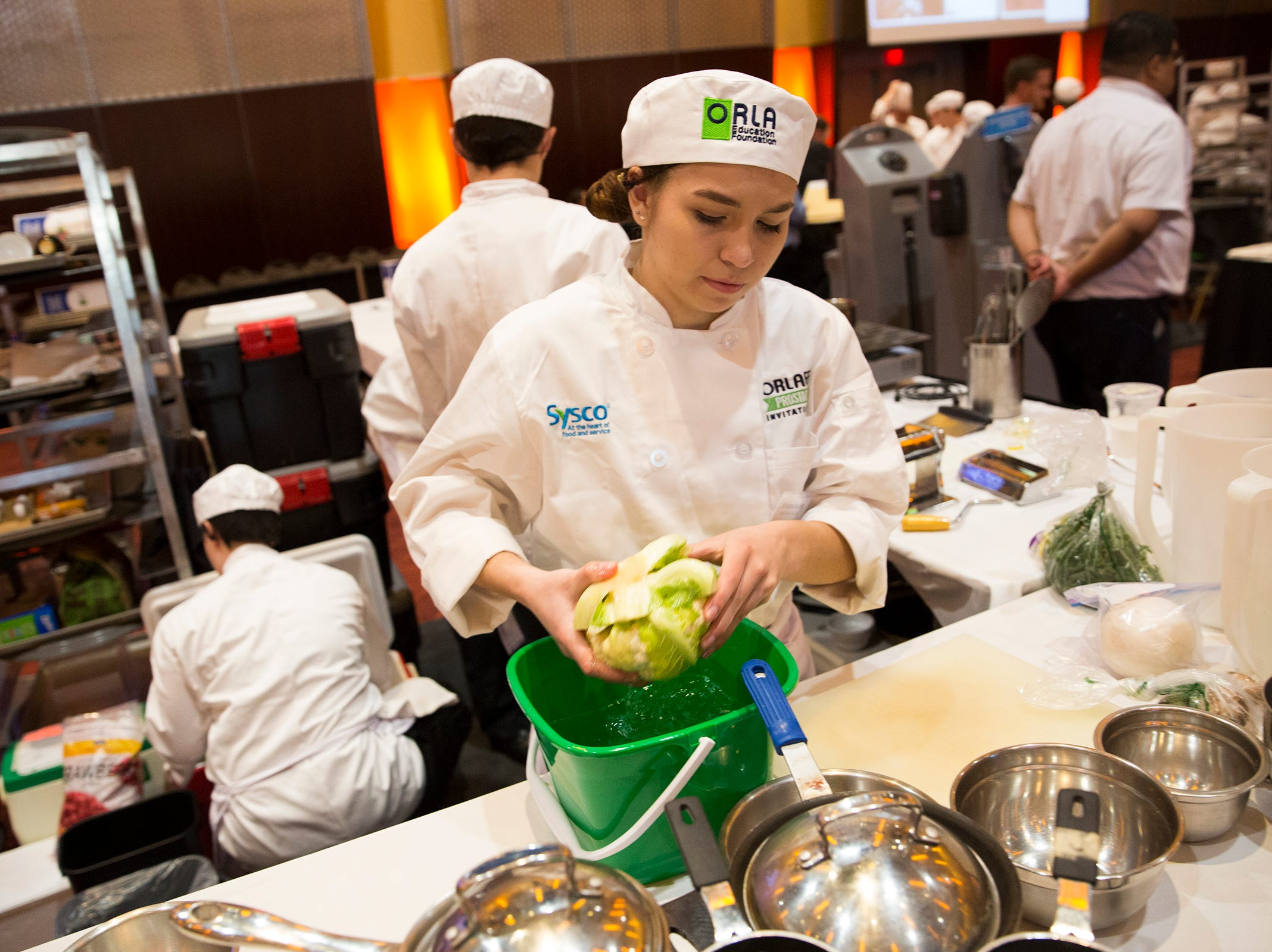 South Salem's Kristen Derting shakes off washed lettuce during the ORLAEF's ProStart Invitational, a statewide high school culinary competition, at the Salem Convention Center on March 18, 2019.