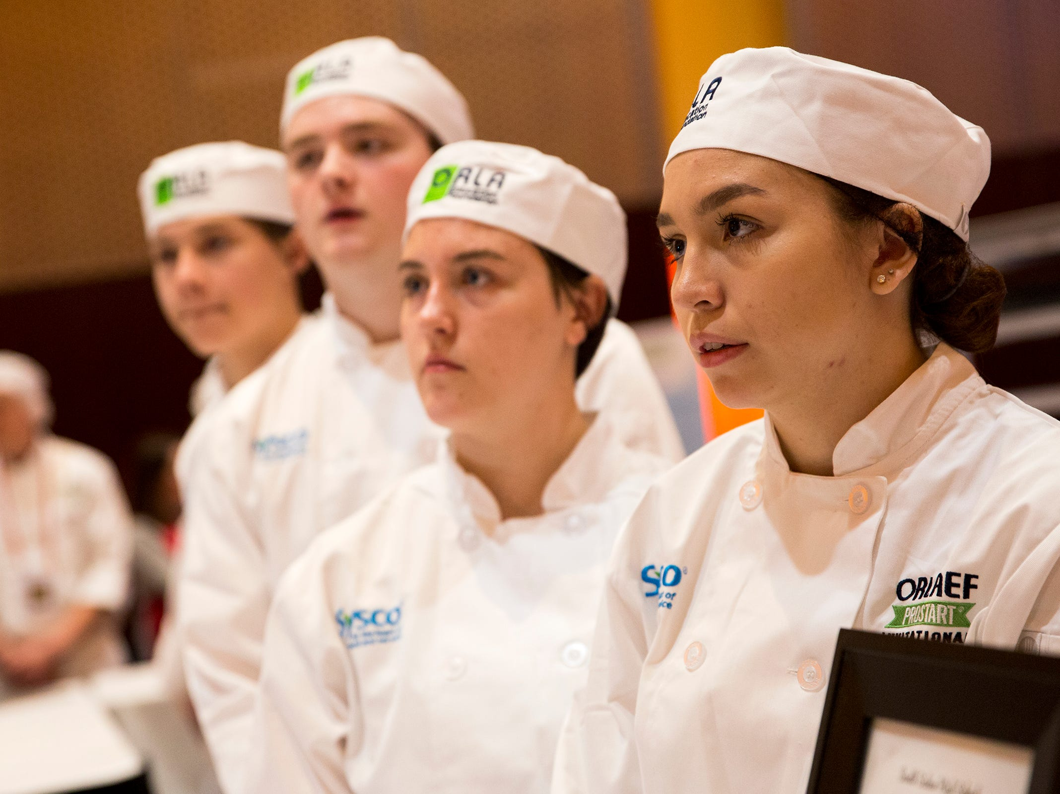 South Salem High School culinary students present their menu to the judges during the ORLAEF's ProStart Invitational, a statewide high school culinary competition, at the Salem Convention Center on March 18, 2019.