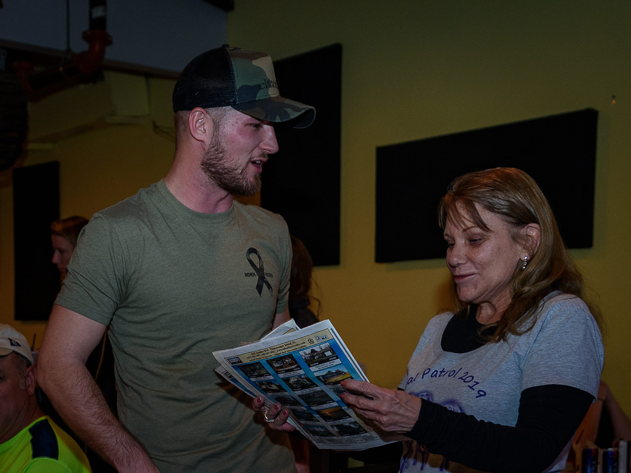 "Singer Dalton Elliott (left) signs autographs and talks to fans during a watch party at Steamers Restaurant and Sports Bar on Chincoteague Island before his ""American Idol"" debut on Sunday, March 17, 2019."