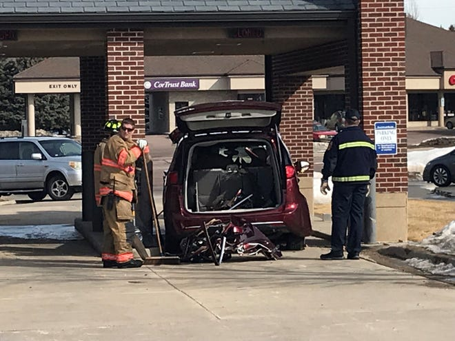 A crashed car at Dacotah Bank near East 57th Street and South Cliff Avenue on March 18, 2019.