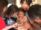Parents Brent and Amy Bussey hold their daughter Rebecca while sister Julia stands by to assist home health care nurse Dan Wyatt administer a shot of the biologic medication Ilaris to Rebecca, 3, in their home in Ladd, Virginia, on Friday, March 15, 2019. Rebecca Bussey has Systemic Juvenile Idiopathic Arthritis, a rare and potentially fatal disease.