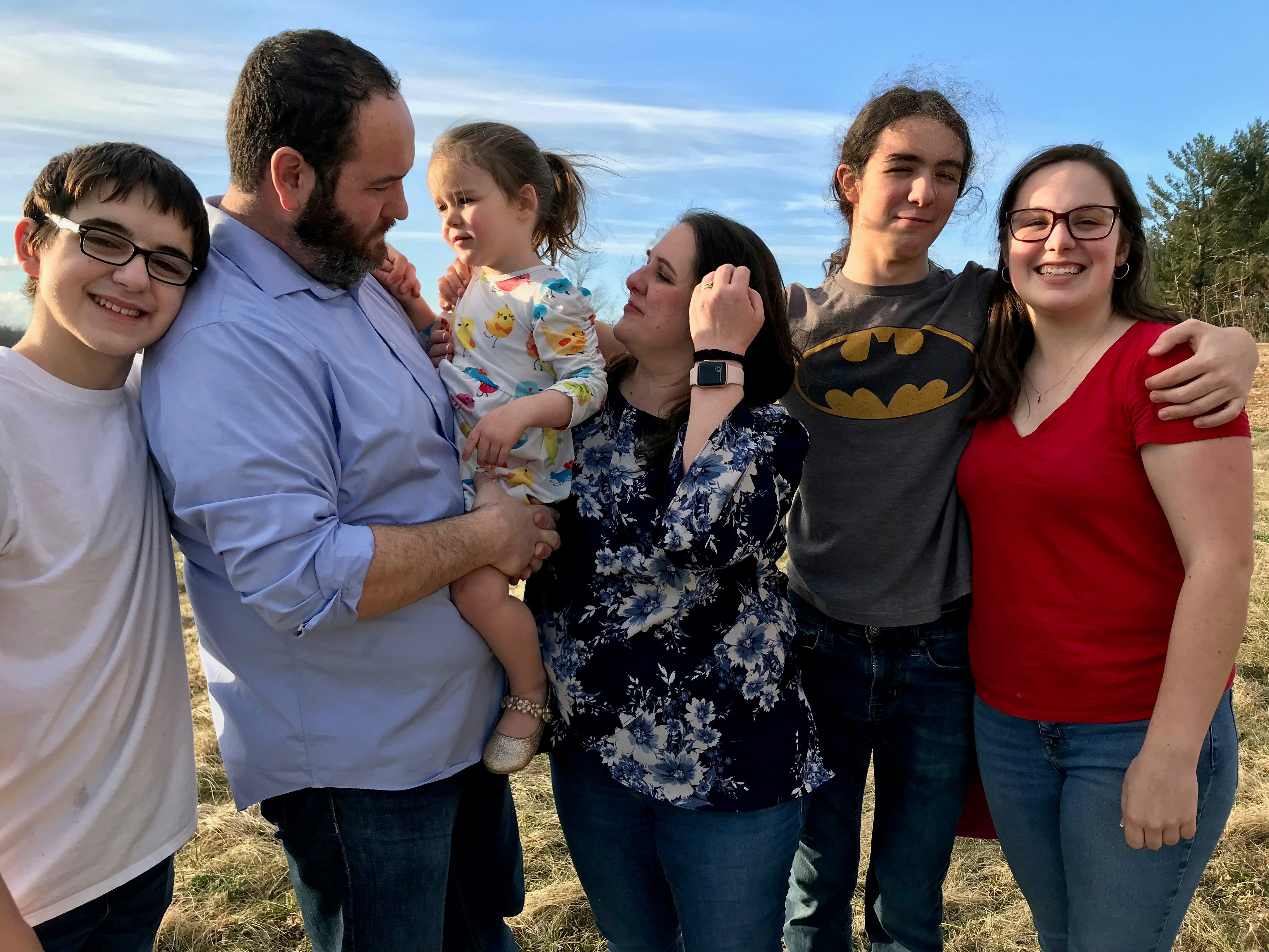 The Bussey family: Wyatt, Brent, Rebecca, Amy, Carter and Julia Bussey in the backyard of their home in Ladd, Virginia, on Friday, March 15, 2019. Three-year-old Rebecca Bussey has the rare disease Systemic Juvenile Idiopathic Arthritis.