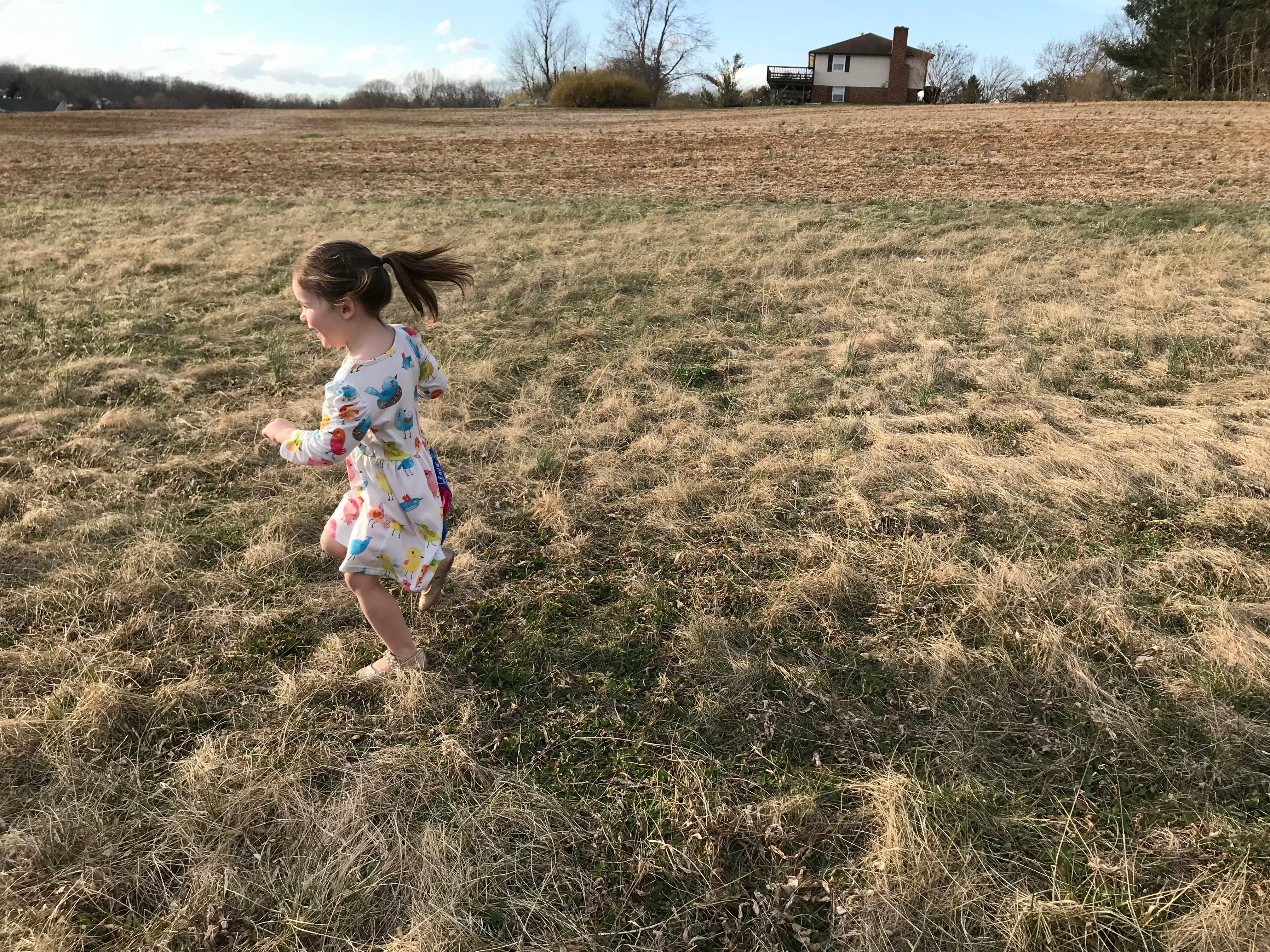 Rebecca Bussey, 3, runs through the backyard of her home in Ladd, Virginia, on Friday, March 15, 2019. Bussey has the rare disease Systemic Juvenile Idiopathic Arthritis.