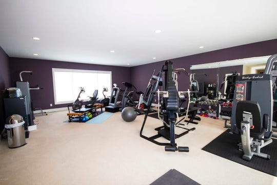 Rounding out the second floor, above the garage, is a vast workout room.
