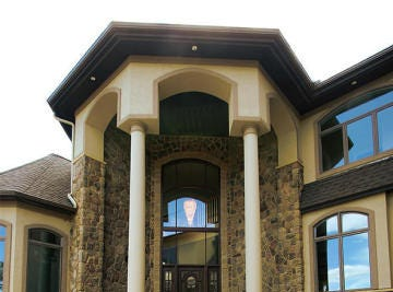 High pillars and soaring windows greet visitors at the majestic front entrance.