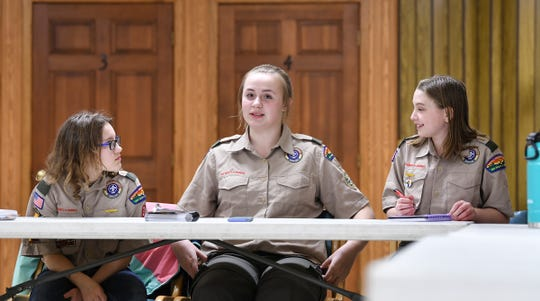 BSA Troop 32 leaders make plans for an upcoming event during a meeting Thursday, March 14, in Avon.