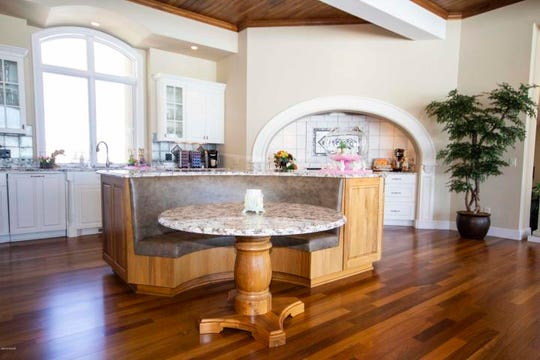 The spacious kitchen, with beautiful wood ceilings, is a cook's and entertainer's dream.