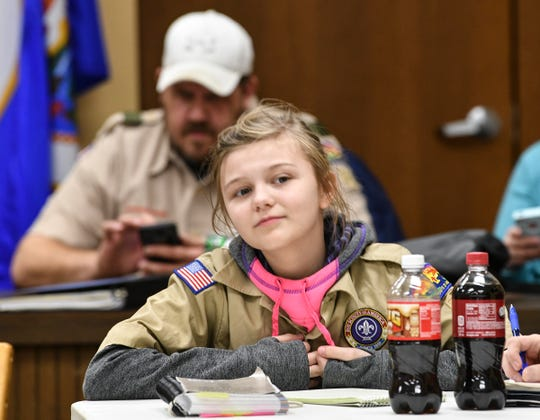 Briele Wolbeck listens during a meeting with BSA Troop 32 members Thursday, March 14, in Avon.