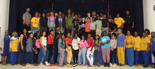 """Mission Possible"" Youth Symposium participants sponsored by the Tallahassee Alumnae Chapter of Sigma Gamma Rho Sorority, Inc., with Griffin Middle School administration, school resource officer, and local author."