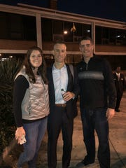 Tim Craft, center, with sister Emily and brother Robert.