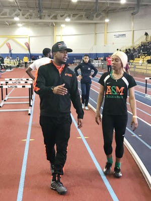 FAMU interim track and field head coach Skye Dawson talks with sprinter Alahni Wood at the MEAC Indoor Championship at Prince George's Sports & Learning Complex in Landover, Maryland.