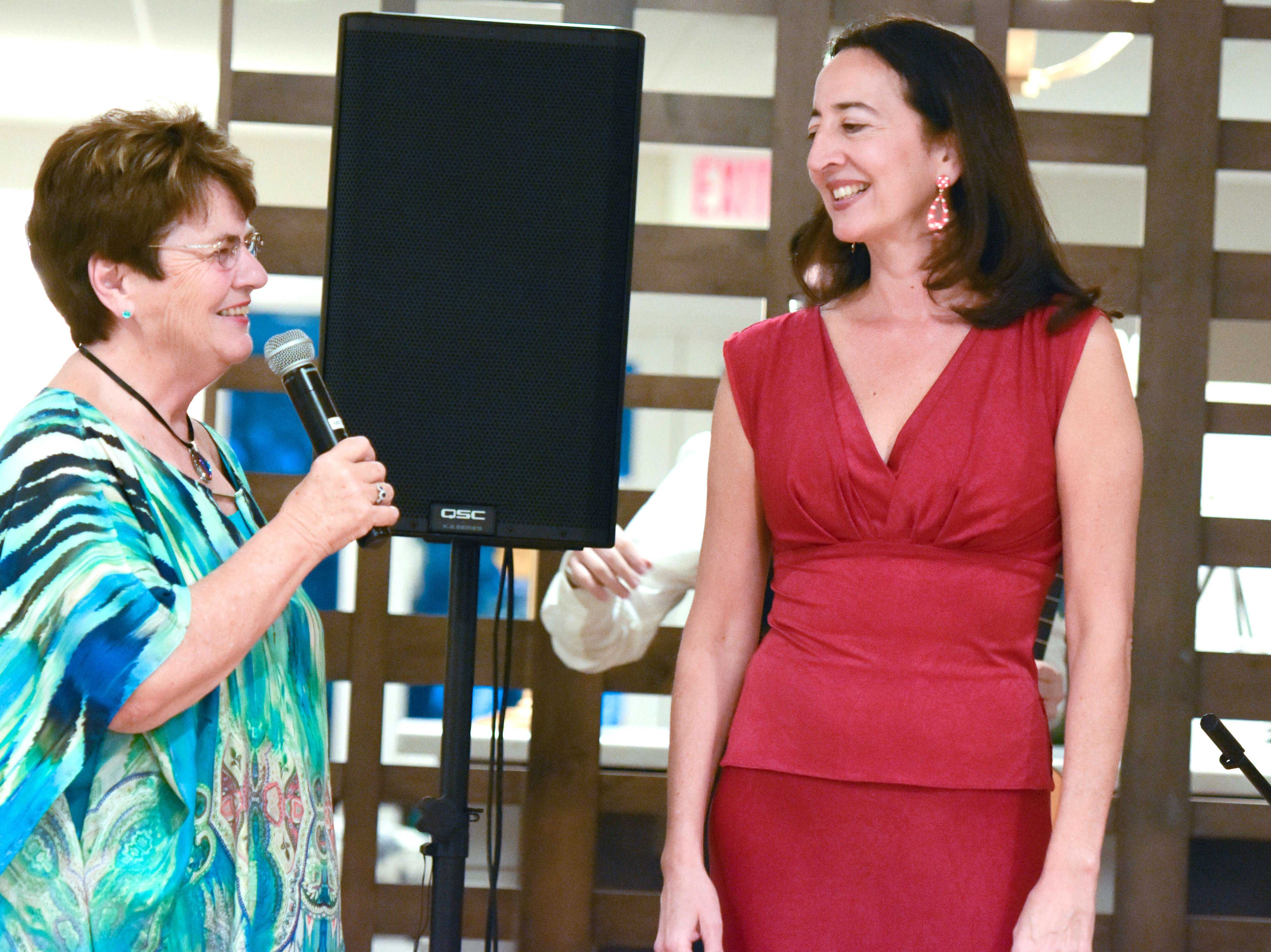 Dr. Marie Jureit-Beamish, left, asks questions of the evening's guest performer Eva Conti at the Stuart Friends of the Atlantic Classical Orchestra's Meet the Artist Dinner at the Stuart Yacht & Country Club.