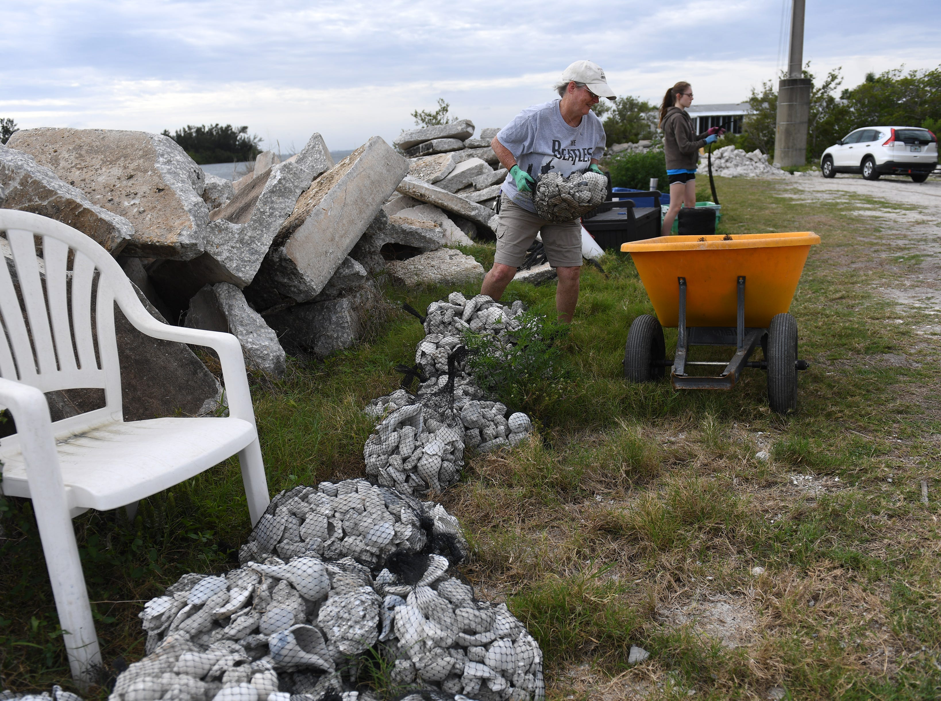 Students, and adults volunteer to help during the Ocean Research & Conservation Association's (ORCA) shell bagging day for the Living Lagoon Program on Monday, March 18, 2019, along the shore of the Indian river Lagoon at the southwest corner of the Alma Lee Loy Bridge behind the water treatment plant, in Vero Beach. The program is about actively restoring the Indian River Lagoon through habitat restoration. Information on how to volunteer can be found at www.teamorca.com.