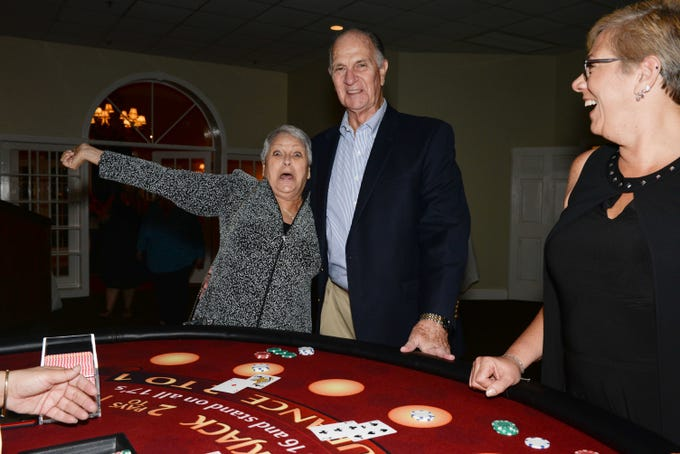 "Pat Engel celebrates hitting 21 at the Blackjack table with Gene Engel and Wende Engel at Renaissance Charter School of St. Lucie's ""Viva Las Vegas"" gala and benefit auction."