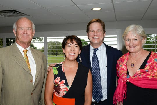 Tom Egan, left, Elizabeth and Craig Price and Hillary Egan attend the Stuart Friends of the Atlantic Classical Orchestra's Meet the Artist Dinner at the Stuart Yacht & Country Club.