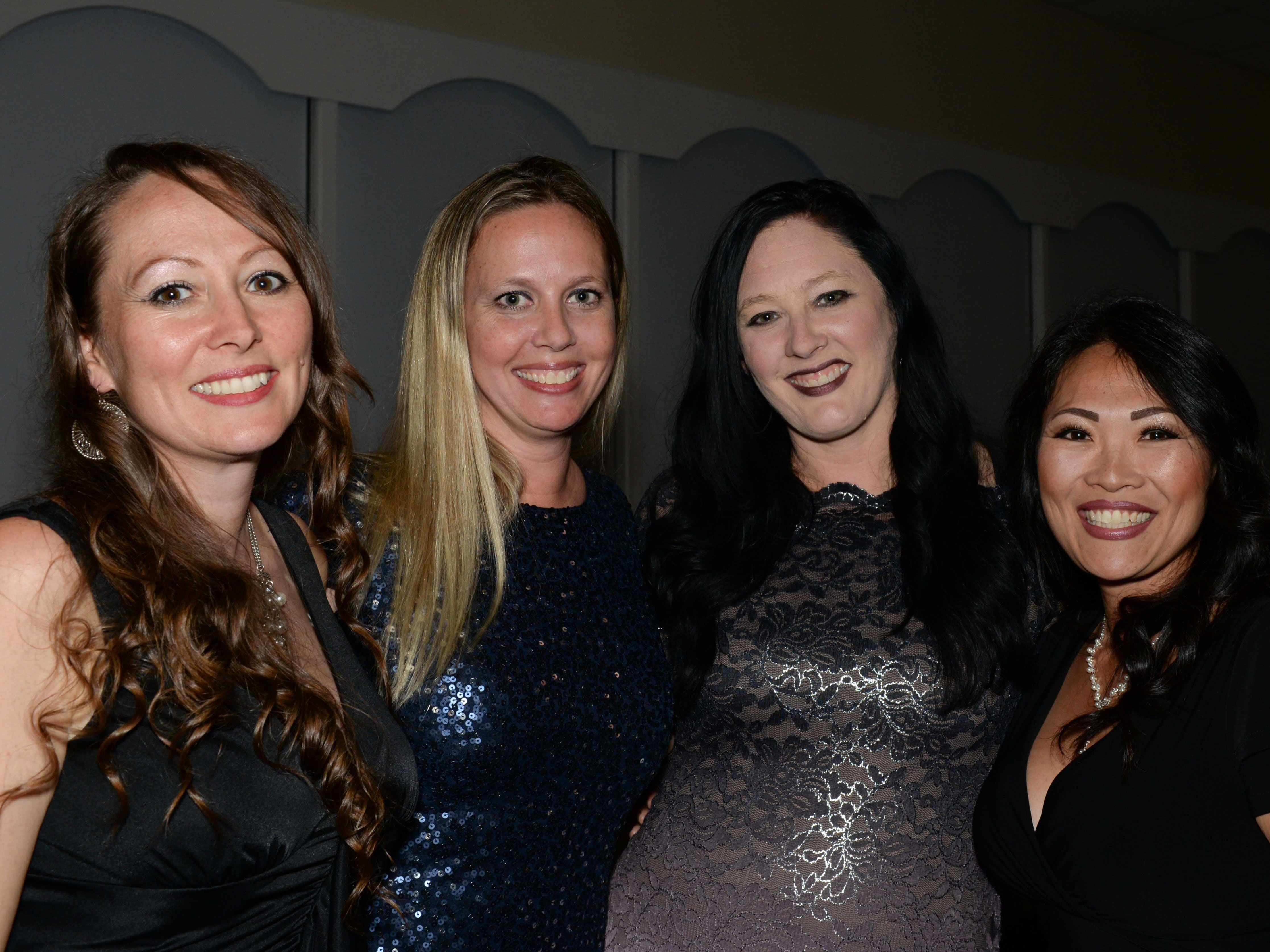"Michelle Leckenbusch, left, Shannon Grillo, Jill Todd and Kim Marchitto at Renaissance Charter School of St. Lucie's ""Viva Las Vegas"" gala and benefit auction."