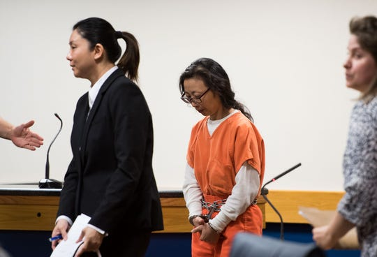 Bridge Day Spa employee Yong Wang (center), represented by attorney Edward Mosher, appears with a translator before Martin County Circuit Court Judge Sherwood Bauer to change her plea Monday, March 18, 2019, at the Martin County Courthouse in Stuart. Assistant State Attorney Marcus Johnson represented the prosecution as Wang pleaded down to accepting proceeds from prostitution.