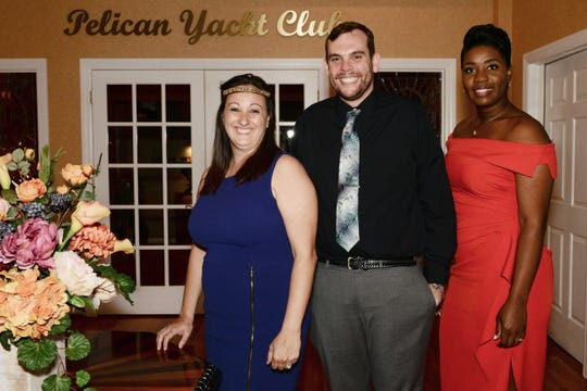 """Principal Christiana Cobun, left, with Assistant Pricipals Jason Wade and Taryn Jackson at Renaissance Charter School of St. Lucie's """"Viva Las Vegas"""" gala and benefit auction."""