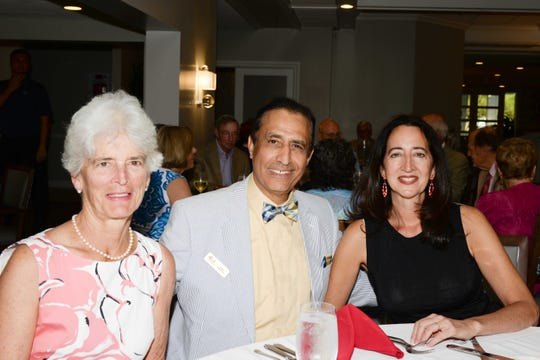 Liz McMullen, left, Kaveh Haghkerdar and Eva Conti at the Stuart Friends of the Atlantic Classical Orchestra's Meet the Artist Dinner at the Stuart Yacht & Country Club.