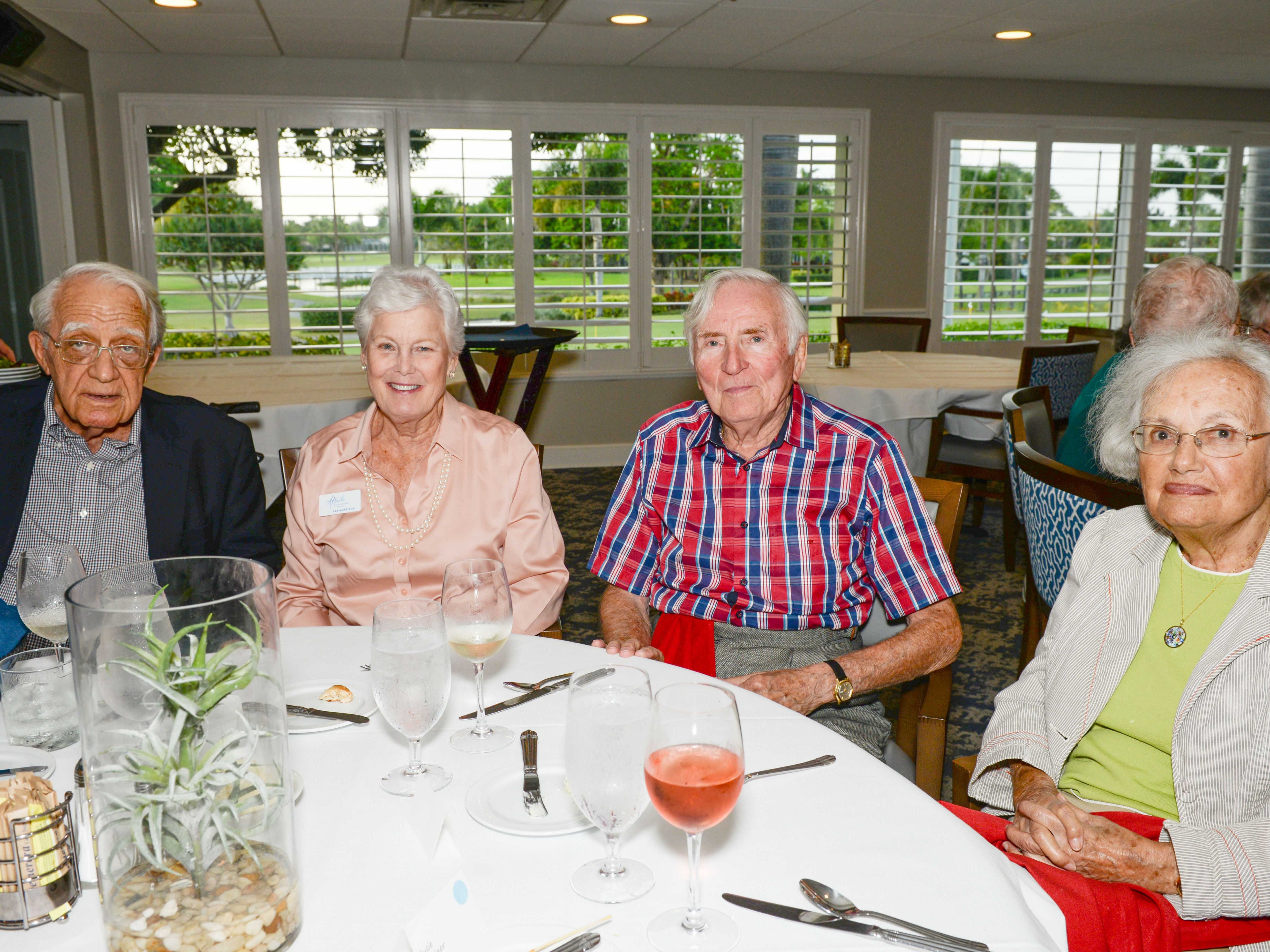 Bill and Lee Morrison, Bud Sterling and Susi Gardner attend the Stuart Friends of the Atlantic Classical Orchestra's Meet the Artist Dinner at the Stuart Yacht & Country Club.