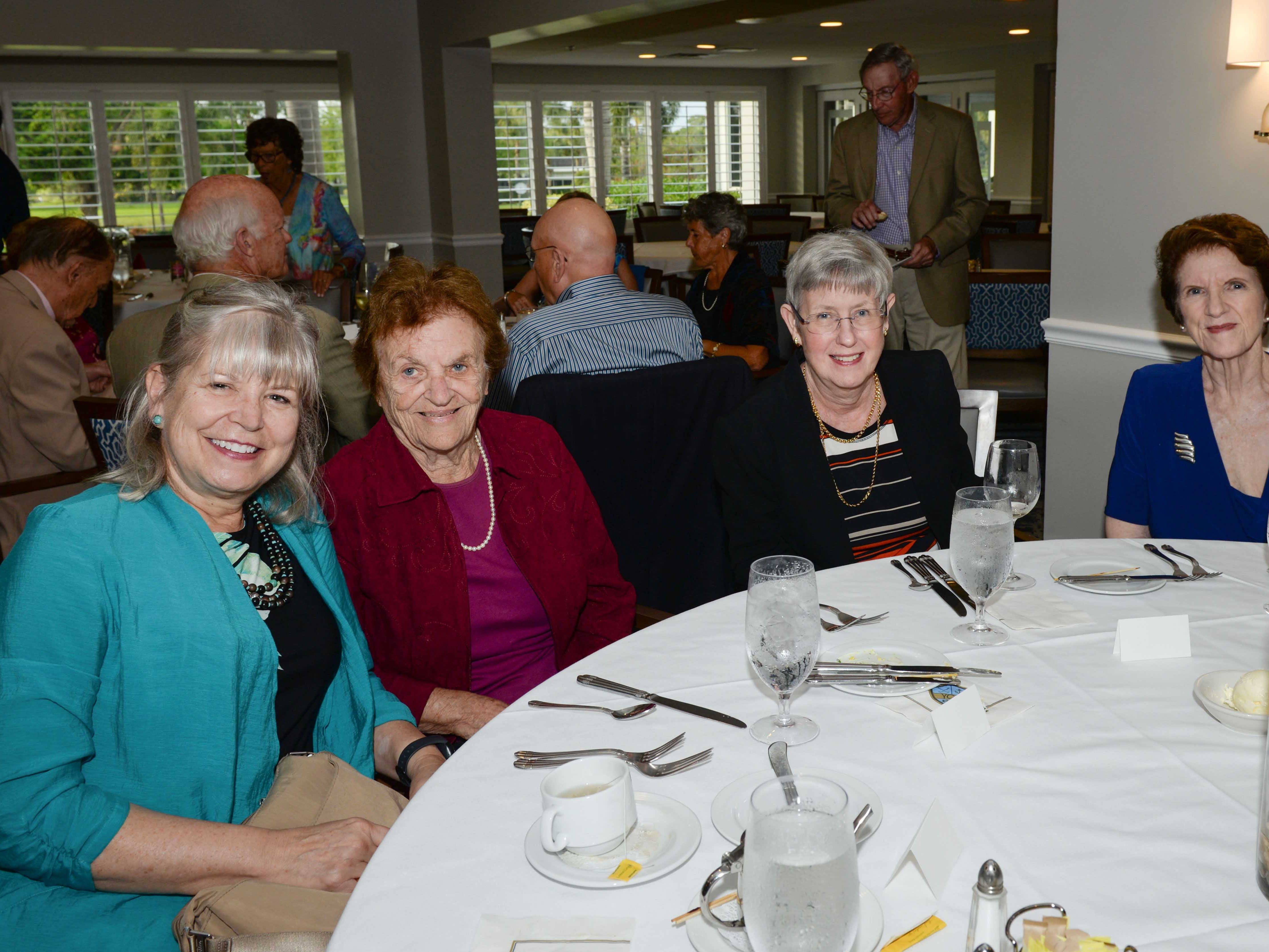 Lora Schwab, left, Diana Doyle, Sue Riddell and Jeanne Hudock attend the Stuart Friends of the Atlantic Classical Orchestra's Meet the Artist Dinner at the Stuart Yacht & Country Club.