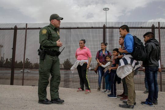 Border Patrol agent Thomas Schwieger approaches a group of 15 migrants at the border in El Paso near Ascarate Park in March 2019.