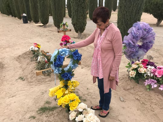 Sylvia Ortiz gets teary-eyed when she visits her father's grave which still does not have a headstone that was ordered and not delivered by G & H Granite.