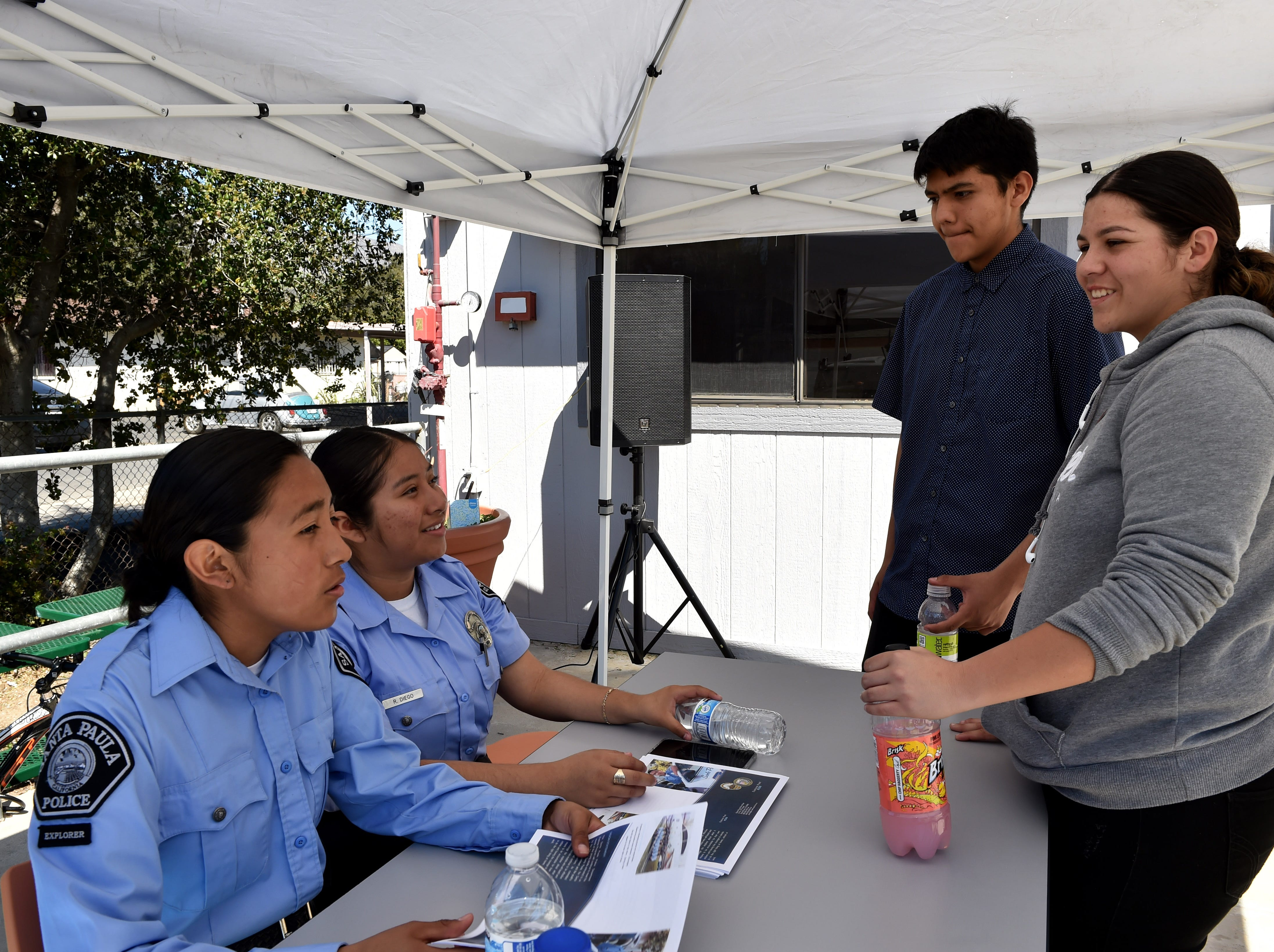 From left, Santa Paula youth Explorers Daysi Gonzalez and Roxana Diega speak with teens Alan Carrillo and Navaeh Delgadillo during an event put on at the Santa Paula Police Department's youth center on Friday.