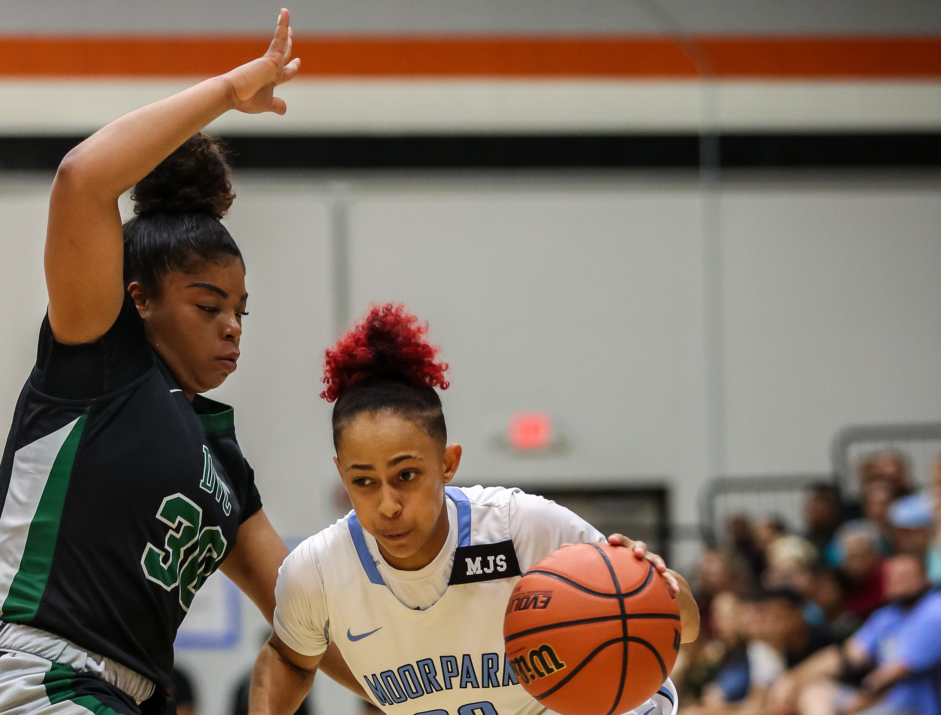 Moorpark College's Breanna Calhoun dribbles around Diablo Valley College's Jahnay Anderson during the CCCAA state championship game at Ventura College on Sunday. Moorpark lost, 68-61.