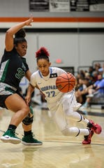 Moorpark College guard Breanna Calhoun, shown playing in last season's state championship game, had a game-high 25 points in Wednesday's win at No. 6 Ventura College.
