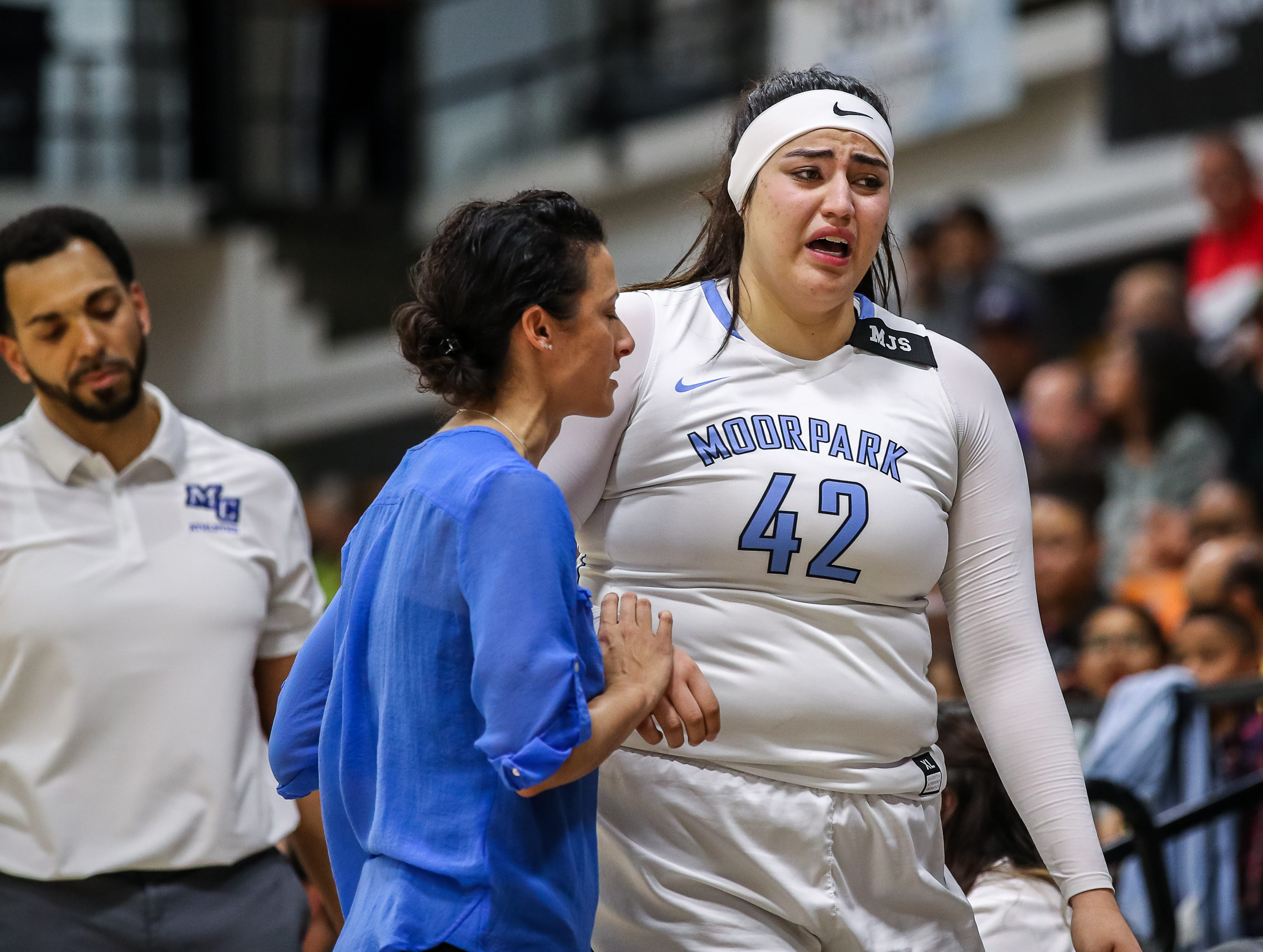 A distraught Barbara Rangel leaves the game after injuring her knee in the third quarter against Diablo Valley College during the CCCAA state championship game at Ventura College on Sunday. Moorpark lost, 68-61.