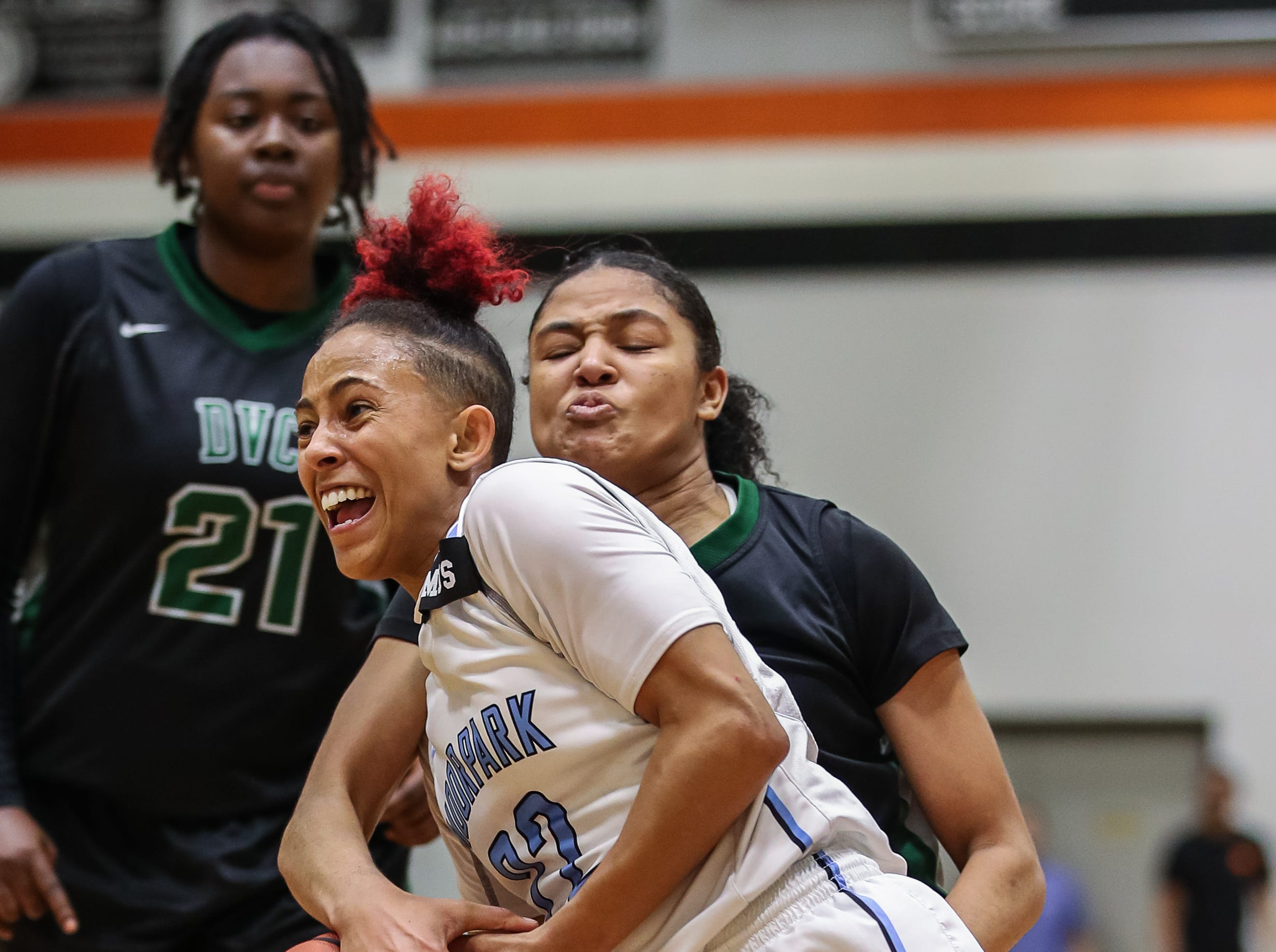 Moorpark College's freshman Breanna Calhoun is stripped of the ball by a Diablo Valley College defender during the CCCAA state championship game at Ventura College on Sunday. Moorpark lost, 68-61.