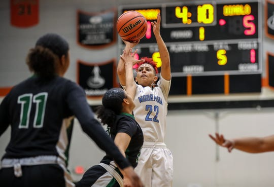 Moorpark College's Breanna Calhoun takes a 3-pointer against Diablo Valley College during the CCCAA state championship game at Ventura College on Sunday. Moorpark lost, 68-61.