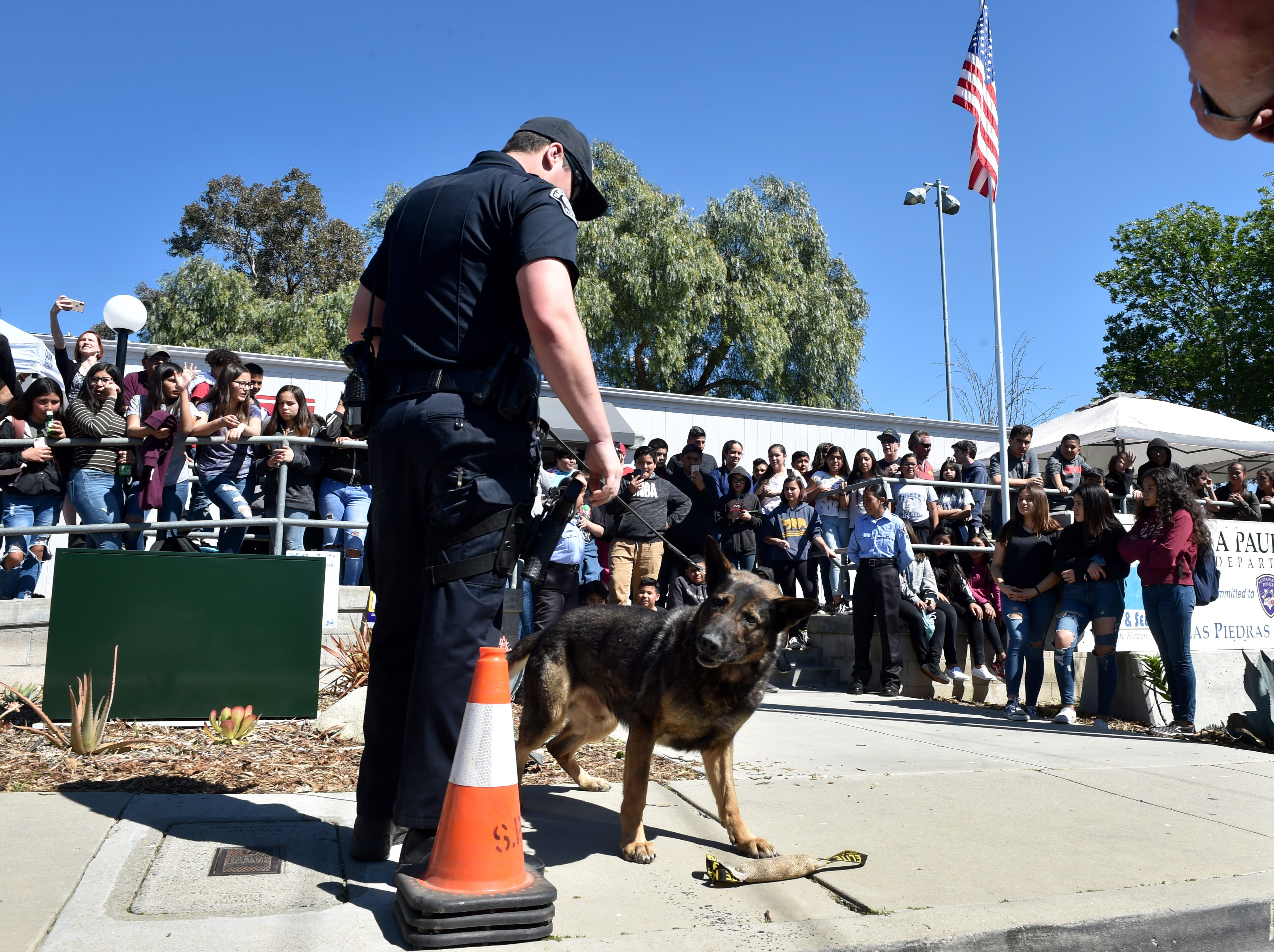 Officer Wyatt Gates and K-9 officer Ace participate in a demonstration for teens at the Santa Paula Police Department's youth center on Friday.